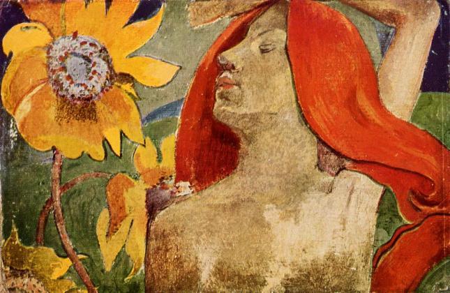 Mujer pelirroja y girasoles