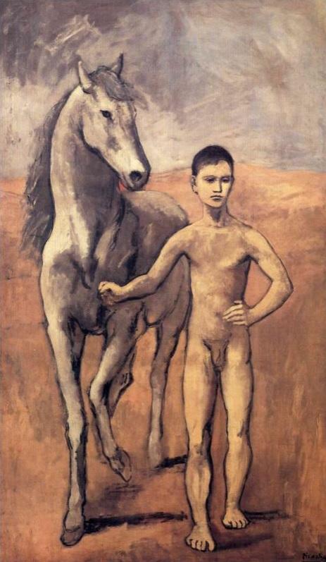 Chico dirigiendo un caballo