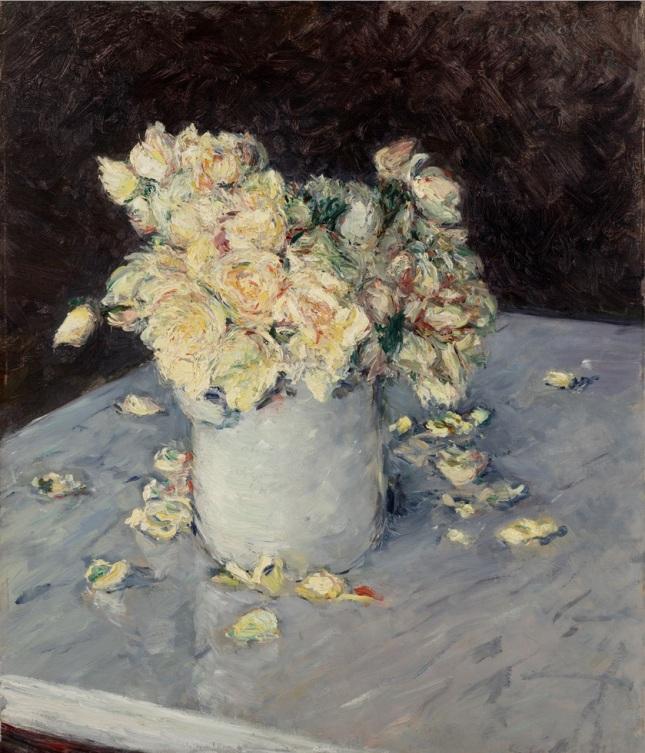 Rosas amarillas en un vaso