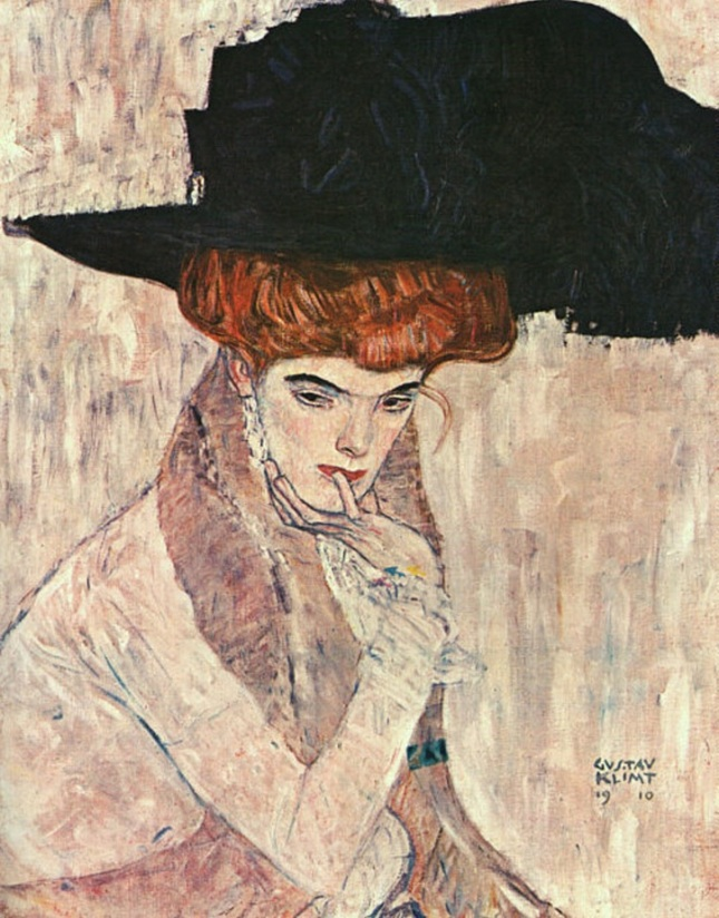 Sombrero con pluma negra