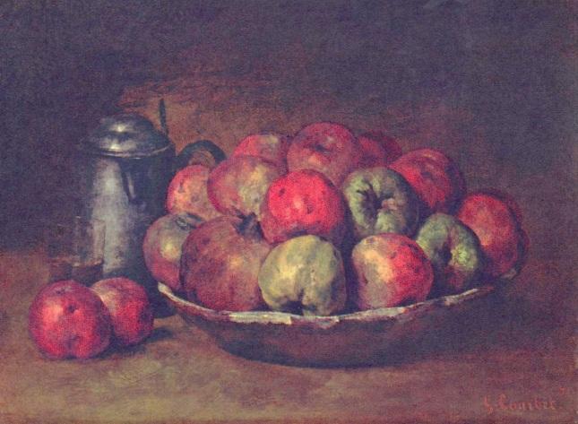 Manzanas y granadas en una copa