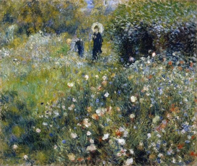 Mujer con sombrilla en un jardín