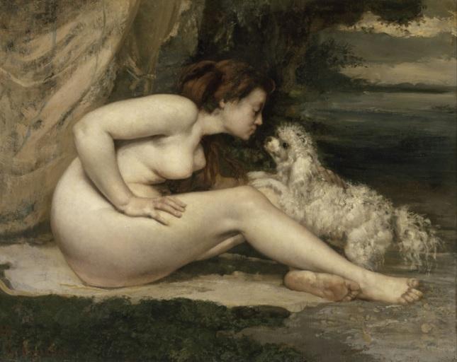 Mujer desnuda con perro