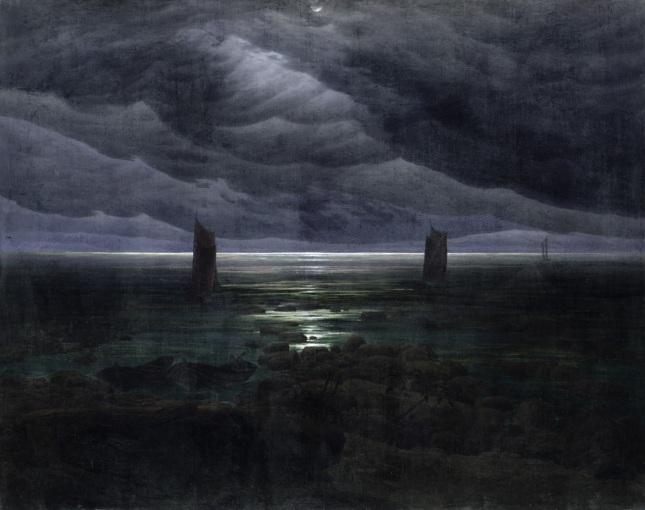 Orilla del mar bajo la Luna